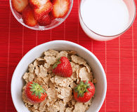 Breakfast cereal with milk and strawberries Stock Photography