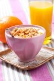 Breakfast with cereal, orange and orange juice Stock Images