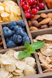 Breakfast cereal and other fresh ingredients in a wooden box Royalty Free Stock Images