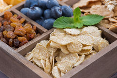 Breakfast cereal and other ingredients in a wooden box Royalty Free Stock Images
