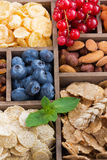 Breakfast cereal and other ingredients in a wooden box, top view Stock Photo