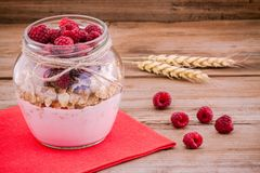 Breakfast: cereal with raspberries and yogurt Stock Image
