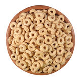 Breakfast cereal rings in a wooden bowl on a white Stock Photography