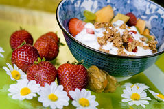 Breakfast Cereal with Strawberries. And flowers royalty free stock images