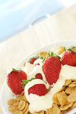 Breakfast cereal with strawberries and cream Stock Photos