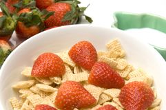 Breakfast cereal strawberries milk Stock Image
