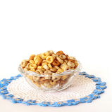 Breakfast Cereal in a Vintage Glass Bowl Isolated on White. A bowl of multi-grain breakfast cereal sitting in a vintage glass bowl and sitting on a crocheted Royalty Free Stock Image