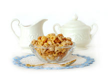 Breakfast Cereal in a Vintage Glass Bowl Isolated on White. A bowl of multi-grain breakfast cereal sitting in a vintage glass bowl and sitting on a crocheted Stock Photography