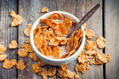 Breakfast cereal wheat flakes in bowl with milk Stock Photo