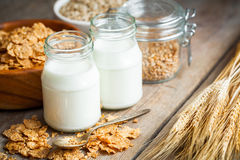 Breakfast cereal wheat flakes, spikes and milk bottles Royalty Free Stock Image