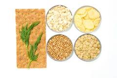 Breakfast cereals: bread, oatmeal, buckwheat, lentils, corn flak. Breakfast cereals on white background Royalty Free Stock Image