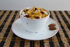Breakfast cereals. Corn flakes with nuts and coconut slices - healthy breakfast Royalty Free Stock Photos