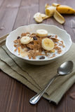 Breakfast cereals with milk and banana Stock Image