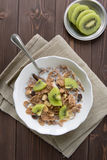 Breakfast cereals with milk and kiwi Royalty Free Stock Images