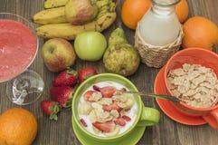 Breakfast. Cereals for breakfast, seasonal fruits and fresh milk Royalty Free Stock Photo