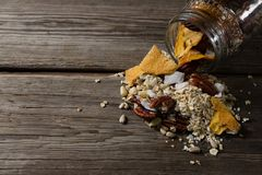 Breakfast cereals spilling from jar Royalty Free Stock Photography