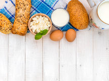 Breakfast of cheese, milk, bread and eggs Royalty Free Stock Images