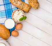 Breakfast of cheese, milk, bread and eggs Royalty Free Stock Photography