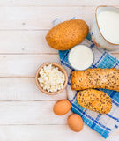 Breakfast of cheese, milk, bread and eggs Stock Photos