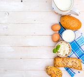 Breakfast of cheese, milk, bread and eggs. On a light wooden background Stock Image