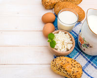 Breakfast of cheese, milk, bread and eggs Royalty Free Stock Photos