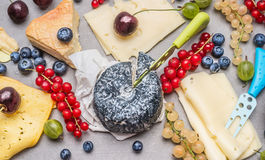 Breakfast cheese plate with various berries Royalty Free Stock Images
