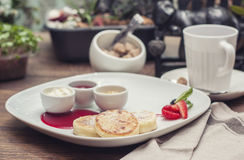 Breakfast cheesecakes on the table in cafe. Royalty Free Stock Image