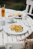 Breakfast with cheesecakes, toast, cappuccino and macarons Stock Image