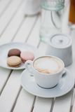 Breakfast with cheesecakes, toast, cappuccino and macarons Stock Photos