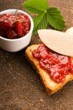 Breakfast of cherry jam on toast Stock Photography