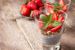 Breakfast with chia pudding, strawberries and muesli Stock Images