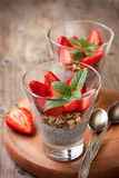 Breakfast with chia pudding, strawberries and muesli Royalty Free Stock Image