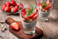 Breakfast with chia pudding, strawberries and muesli Stock Photo