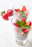 Breakfast with chia pudding, strawberries and muesli Royalty Free Stock Images