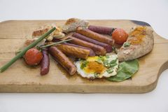 breakfast with chicken and sausages Stock Photography