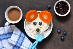 Breakfast for child - cereal with fruits and berries. Cocoa beve. Rage royalty free stock photo