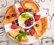 Pancakes with berries on breakfast Stock Image