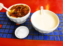 Breakfast in China, soya milk & savory beancurd. Two dishes of typical chinese breakfast food in Beijing, China.  Left is a bowl of savory beancurd with Stock Images