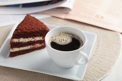Breakfast with chocolate cake and coffee stock images