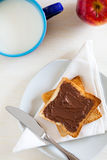 Breakfast with Chocolate Spread on Toast Stock Photo