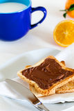 Breakfast with Chocolate Spread on Toast Royalty Free Stock Photos
