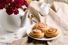 Breakfast with cinnamon buns Stock Photo