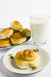 Breakfast with cinnamon buns and glass of milk on a white background. Royalty Free Stock Photography
