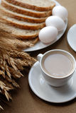 Breakfast with cirn. Lovely breakfast with coffe, three eggs and corn Royalty Free Stock Image