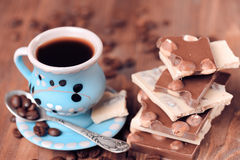 Breakfast closeup. Chocolate bars with cup of coffee, selective focus Stock Photography