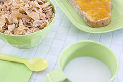 Breakfast. Closeup of a healthy continental breakfast consists of cup of milk, bowl of cereals and a toast with butter and peach mermelade Stock Photos