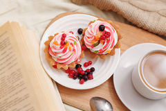 Breakfast with coffe and tasty cakes Stock Photos