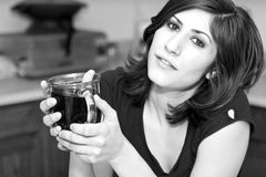 Breakfast Coffee. Young brunette woman with a large cup of dark breakfast coffee Stock Photos