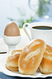 Breakfast with coffee. Breakfast includes brioche,egg and coffee royalty free stock images