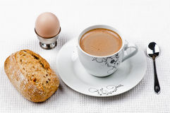 Breakfast and coffee. Table with breakfast and coffee, bread and egg Stock Photography